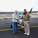 Gary congratulated by Paul Hesse of Empire Aviation.