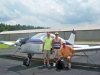 Brandon and Torrey Rueger both Eagle Scouts flying with Sparky the wonder dog in a Cherokee